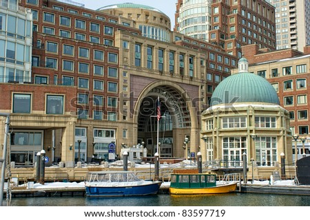 View of the arched entrance to  Historic Rowe's Wharf from inside the wharf in the south end of Boston Massachusetts in winter.
