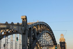 View of the arched span and the bridge tower. On the portal part of the inscription: