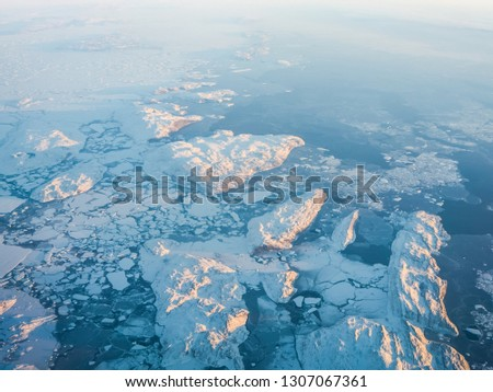 View of the Arctic ice from the plane, the expanses of the Arctic. View of the Arctic ice from the plane, the expanses of the Arctic. #1307067361