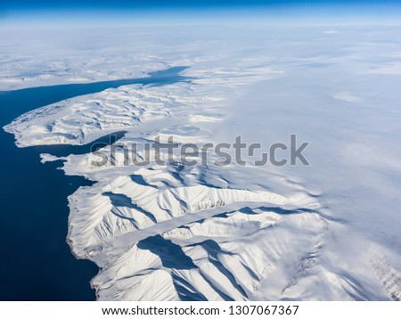 View of the Arctic ice from the plane, the expanses of the Arctic. View of the Arctic ice from the plane, the expanses of the Arctic. #1307067367