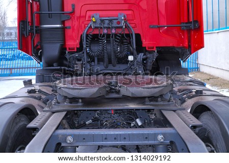 View of the back part of the 18 wheeled truck. Visible fifth wheel couplings are fitted to a tractor unit to connect it to the trailer. #1314029192