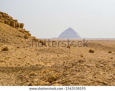 View of the base of the Red Pyramid with the Bent Pyramid in the background. Dahshur necropolis, Cairo, Egypt