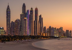 View of the bay and the skyscrapers of Dubai Marina at sunset.