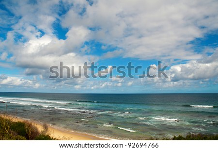 View of the beach at Rhebok showing long waves and cloudy sky