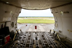 View of the big opening at the front of a Jumbo Jet freighter aircraft's main deck, after the nose cargo door has been opened completely