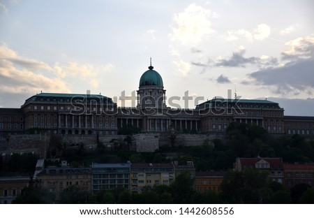 View of the Buda Castle (Hungarian: Budavári Palota) through Danube river from Pest side. It is a historical castle and palace complex of the former Hungarian kings in Budapest Stock fotó ©