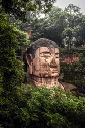 View of the Buddha statue head in Leshan, China. Leshan Buddha is the world's largest statue of Buddha, whose height is 71 meters.