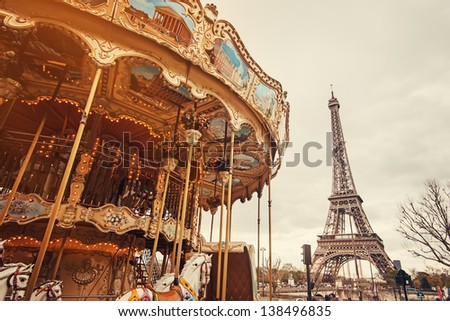 View of the carousel and the Eiffel Tower at sunset.