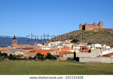 View of the castle, built 1509 � 1512, (Castillo de La Calahorra) and town, Lacalahorra, Granada Province, Andalusia, Spain.