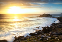 View of the Castro de Baroña at sunset
