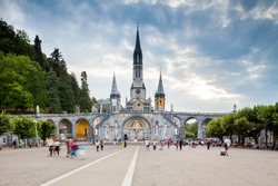 View of the cathedral in Lourdes, France at sunset