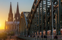 view of the Cathedral of cologne and the Hohenzollern Bridge at sunset, germany