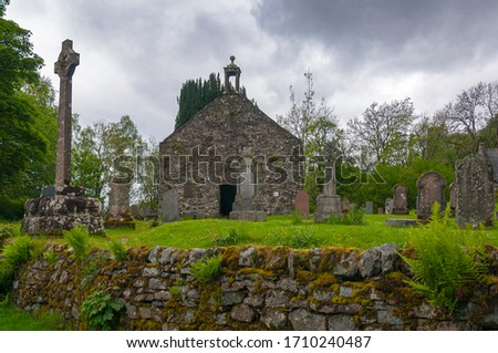 View of the cemetery of the Balquhidder Parish church, Lochearnehed, Scotland. Concept: religion and spirituality, mysterious and fantastic places in scotland stock photo