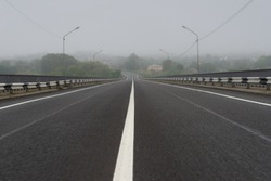 View of the center of the road with fog on the background