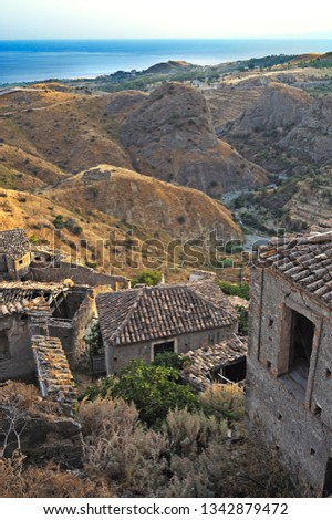 view of the characteristic historical center of Pentedàttilo, in the background the Ionian coast, district of Reggio Calabria, Calabria, Italy, Europe #1342879472
