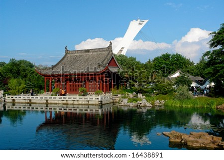 View of the Chinese Garden in Montreal with the olympic stadium in the background