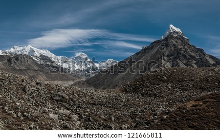 View of the Chola (6069 m), Mt. Everest (8848 m) and Lhotse (8516 m) on  background - Gokyo region, Nepal, Himalayas