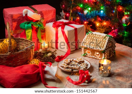 View of the Christmas table with presents and a Christmas tree