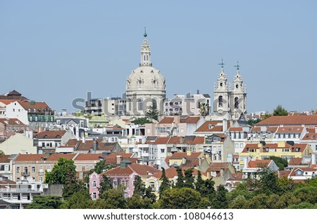 """View of the church """"Basilika Estrela"""" and the old town of Lisbon in Portugal"""