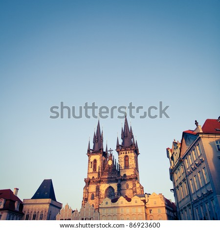 View of the Church of Our Lady before Týn (Tyn Church) and the houses of the Old Town Square in Prague at dusk