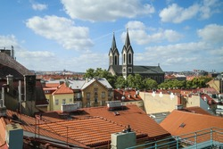 View of the Church of St. Cyril and Methodius from the office building in Prague 8 Karlín, Czech Republic. We can see beautiful cityscape with the church as the dominant feature and with roofs around.