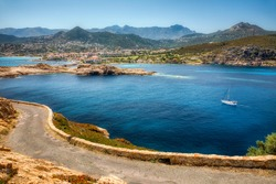 View of the City of L'Ile Rousse on Corsica, France, as Seen from Ile de la Pietra