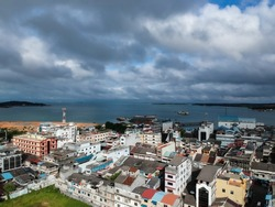 View of the city of Tanjungpinang, with cloudy sky when the sun is covered by clouds