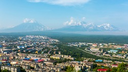 View of the city Petropavlovsk-Kamchatsky on background of Volcanoes. Russian Far East, Kamchatka Peninsula.