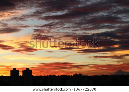 View of the city skyline at dusk, beautiful landscape of the setting sun #1367722898