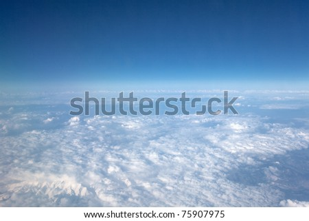 View of the clouds from the airplane in flight.