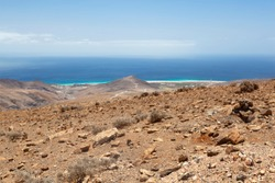 View of the coastline near Morro del Jable in Fuerteventura, Spain from the mountains.