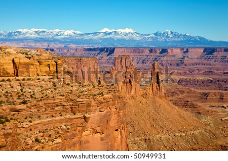 View of the Colorado River canyon and La Sal mountains, from Mesa Arch. Canyonlands National Park, near Moab Utah.