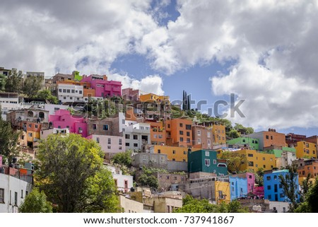 View of the colorful city of Guanajuato in Mexico. Every house is painted to different bright color giving a very cheerful atmosphere to the city. Captured on a sunny cloudy day.