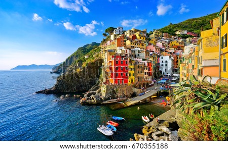 View of the colorful houses along the coastline of Cinque Terre area in Riomaggiore, Italy.