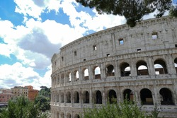 View of the Colosseum in Rome with clouds sky