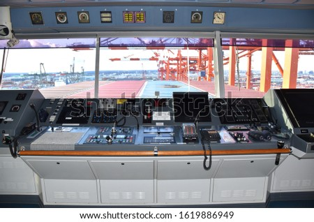 View of the control console on the navigational bridge of the cargo ship. Ship berthed in the port of Newark.  Сток-фото ©