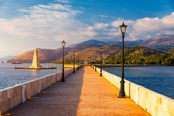 View of the De Bosset Bridge in Argostoli city on Kefalonia island. De Bosset Bridge on lakeside In Argostoli, Kefalonia. Obelisk and the de Bosset bridge in Argostoli, Kefalonia, Greece