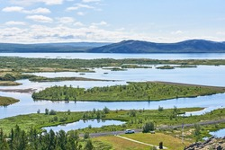 View of the delta of the Oxara River in Thingvellir National Park, Iceland on a clear summer day. Thingvallavatn lake is beyond.