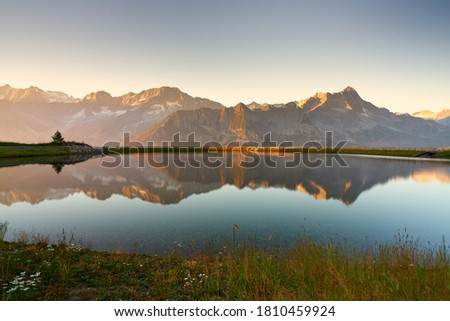 View of the dolomites over Passo del Tonale from bacino di Valbiolo at sunrise Stock fotó ©