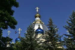 View of the domes and crosses of the church of St. Panteleimon in the early summer morning