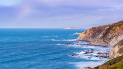 View of the dramatic Pacific Ocean coastline, with rocky cliffs, on a sunny day, Point Reyes National Seashore, California