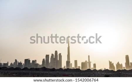 View of the Dubai skyline silhouette. Dubai, United Arab Emirates.