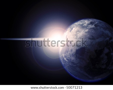 View of the earth with bright light behind it