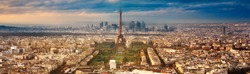 View of the Eiffel tower at sunset from Tour Montparnasse, Paris.