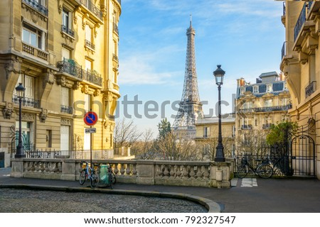View of the Eiffel Tower from a small cobbled dead-end street of the Chaillot hill by a sunny winter afternoon.