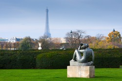 view of the Eiffel Tower, from the Louvre through the Tuileries Gardens