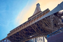 View of the Eiffel tower on a clear blue sky day. view from below the tower