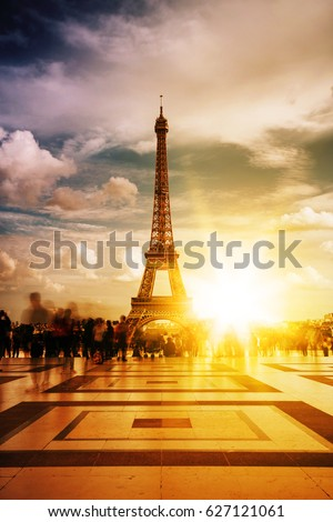 View of the Eiffel tower, Paris symbol and iconic landmark in France, on a bright sunny day. Famous touristic places and romantic travel destinations in Europe. Travel and tourism concept. Toned #627121061