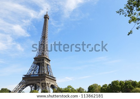 View of the Eiffel Tower with blue sky and white clouds, Paris, France - stock photo