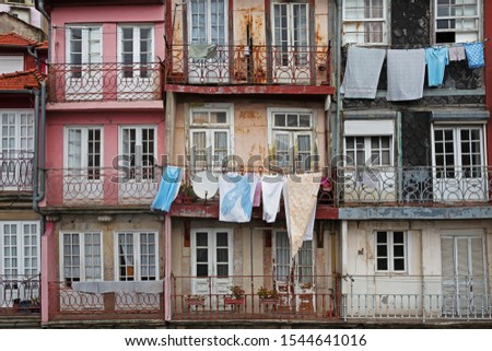View of the facades of houses with balconies where clothes are dried #1544641016